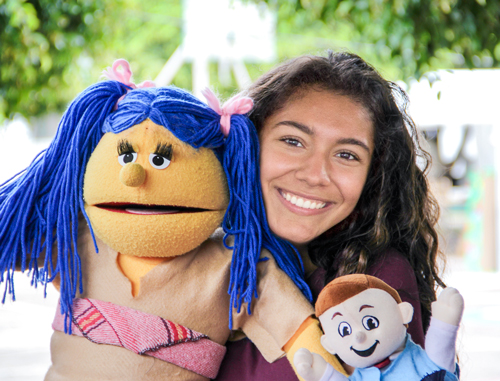 Girl with puppet at Service Adventure