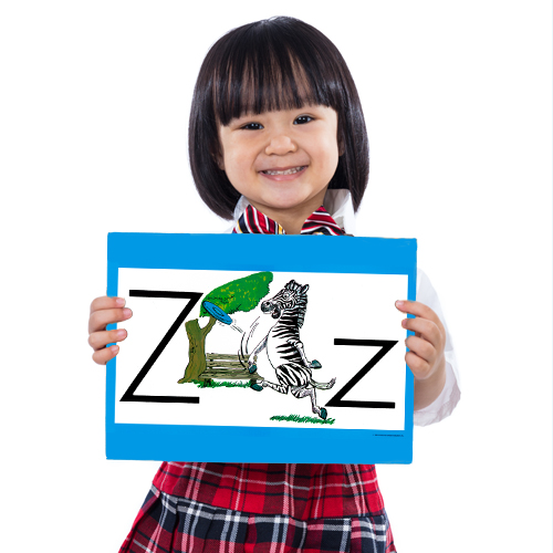 student holding ABCs display card
